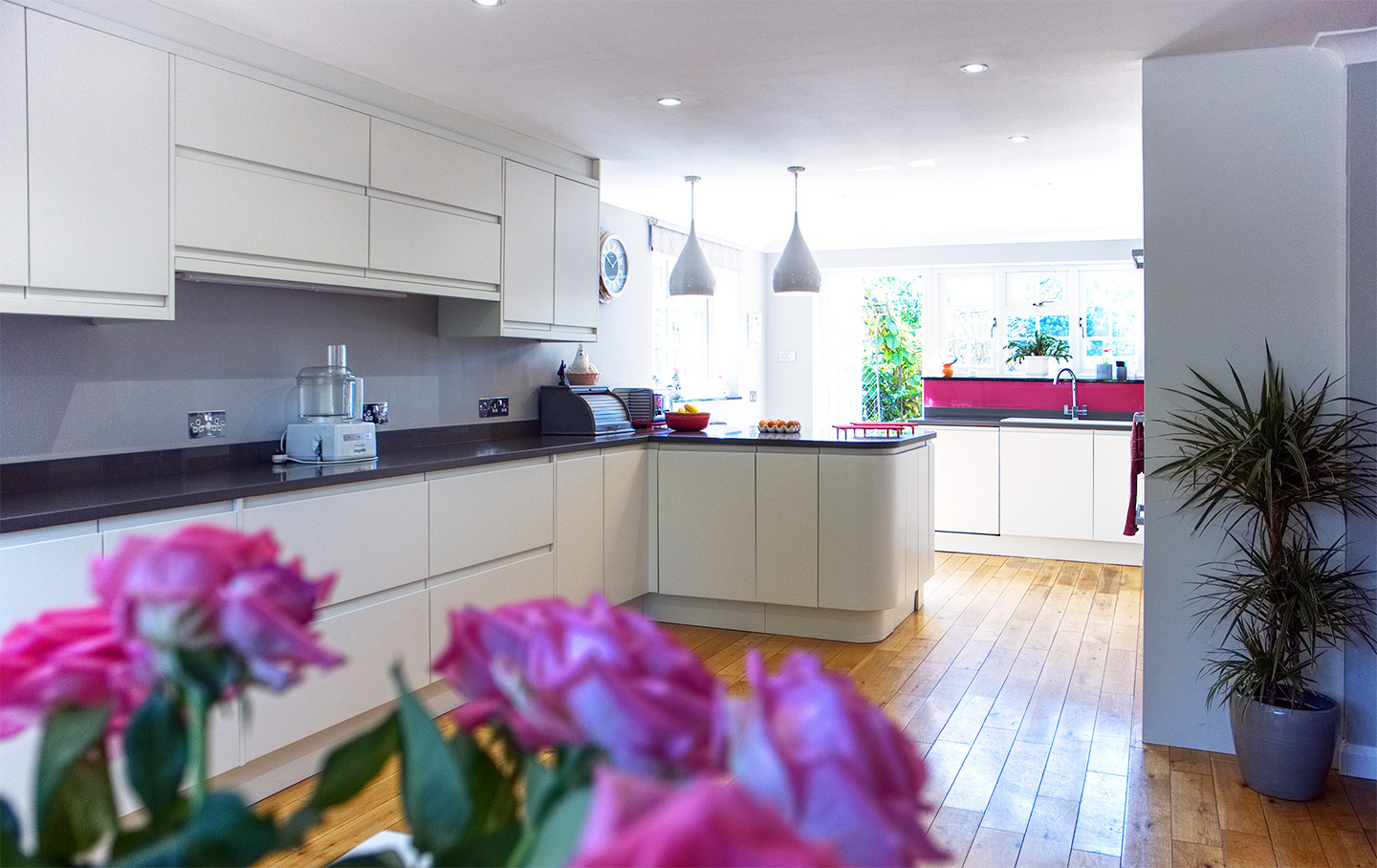 modern kitchen pink splashback fitted